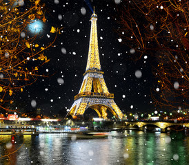 PARIS, FRANCE - DECEMBER 09,2016: Eiffel Tower light performance show in Paris by Christmas snowy night. Eiffel Tower is most visited monument in France and use 20,000 light bulbs in the night show