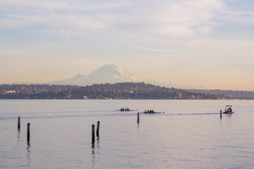 Mount Rainier overlooking Lake washinton and rowers in foreground