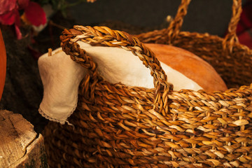Close up shot of a  pumpkin and basket, autumn composition