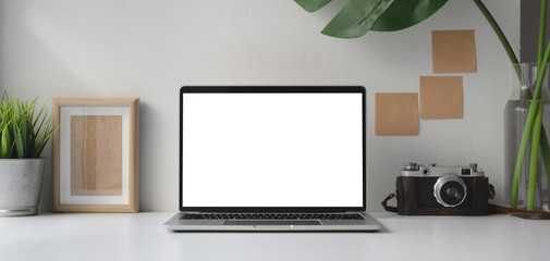 Wall Mural - Modern office room with blank screen laptop computer and camera with office supplies