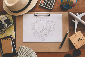 Overhead view of Traveler's accessories, on the table in composition Essential vacation items, Travel concept background