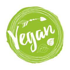 Handwritten lettering sign Vegan for restaurant, cafe menu on the green spot