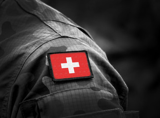 Flag of Switzerland on military uniform. Swiss flag on soldiers arm. Armed Forces, Army. Collage.