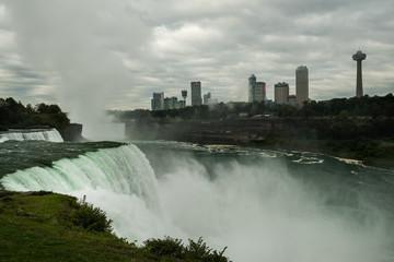 Fotomurales - View of the cascades of Niagara Falls. A wonderful powerful stream of falling water. Niagara Falls. USA,