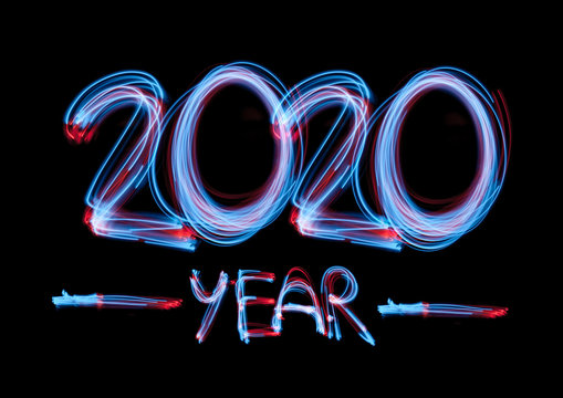 2020 in neon multi colour design, parallel lines pattern on black background. Holidays, celebrating night, New Year and Christmas event, bright colors. Copyspace, advertising.