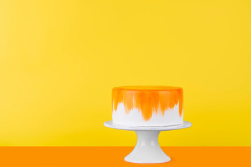 Colorful cake on stand. Copy space concept. Poster idea.