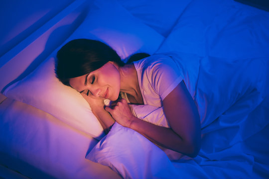 Close-up top above high angle view portrait of her she nice attractive lovely dreamy brunet girl lying in bed covered white blanket head on pillow sleeping peacefully alone at night room house flat