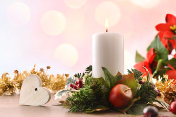 Candle on table with Christmas floral center and heart front