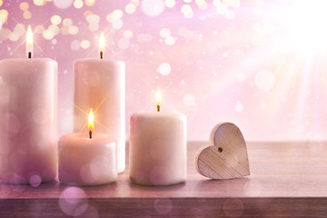 Candles with pink dreamy background with heart and lights