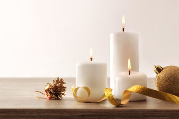Simple Christmas composition with candles and Christmas elements on table
