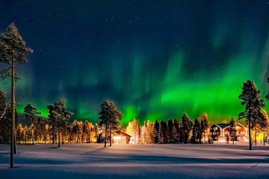 Aurora borealis (also known like northern or polar lights) beyond the Arctic Circle in winter Lapland.