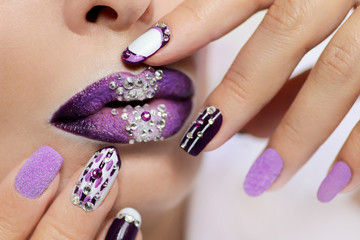 Purple and white nail design on different nail length and shape.Creative nail art.Lip makeup with rhinestones.