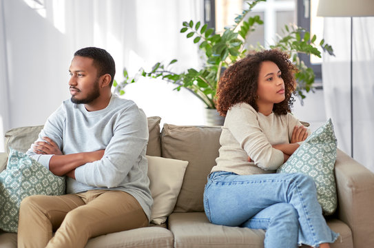 relationship difficulties, conflict and people concept - unhappy african american couple having argument at home