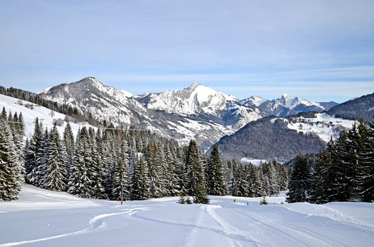 Beautiful peaceful winter landscape in the Frence Alps, at one of the ski stations, France. The view on the empty ski slopes