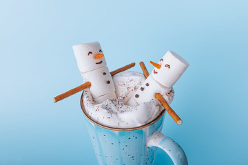Christmas and winter vacation concept for two in spa and relaxation. two marshmallows in a mug of...