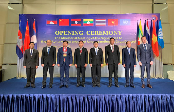 Ministers from countries of the Mekong Memorandum of Understanding (MOU) on Drug Control, and a UNODC representative, pose for a photograph after a morning meeting, in Bangkok