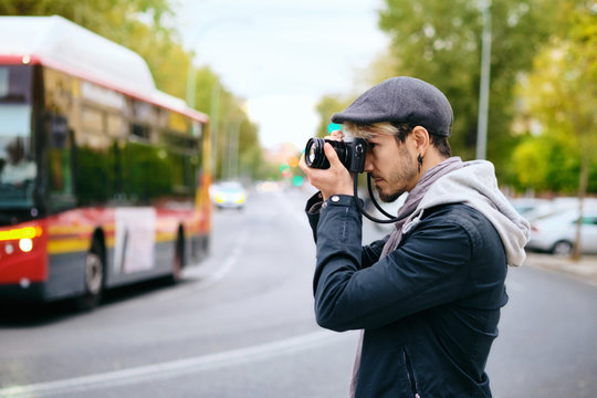 Hipster Photographer Taking Street Pictures With Mirrorless Camera