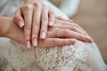 Close up of woman hands with pastel wedding manicure, copy space Wall mural