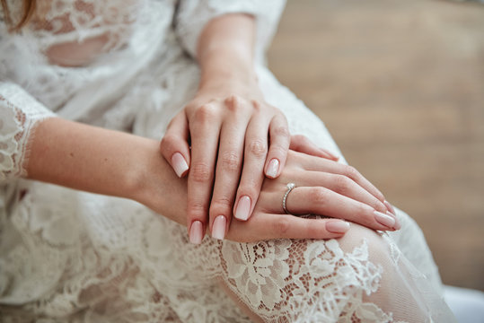 Close up of woman hands with pastel wedding manicure, copy space