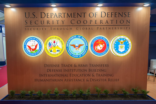 US Department of Defense with combined military signs at a trade event in Farnborough, UK - July 20, 2018