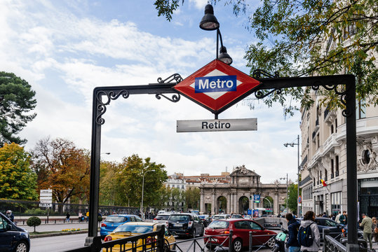 Metro sign in Callao Subway Station against Capitol Building on background in Gran Via avenue in Madrid, Spain