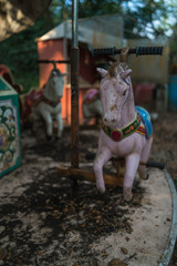 Rocking horse in a abandoned amusement park