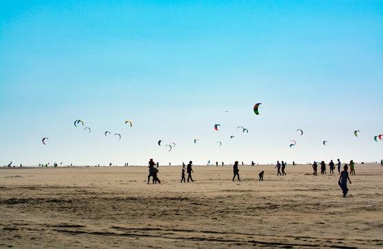 Water sport event, kite surfers race in North Sea near Renesse, Zeeland, Netherlands