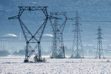 Pylons of high-tension electricity power lines are seen after heavy snowfall in Saint -Vulbas