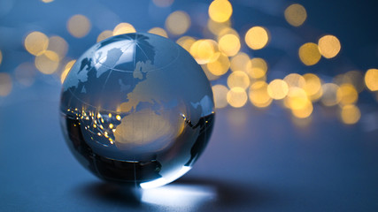 European Union on a glass ball in front of shining lights Wall mural