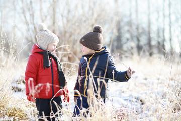 Children in winter park play