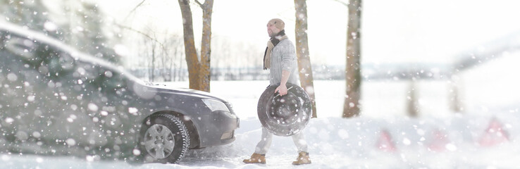 A man near a broken car on a winter day