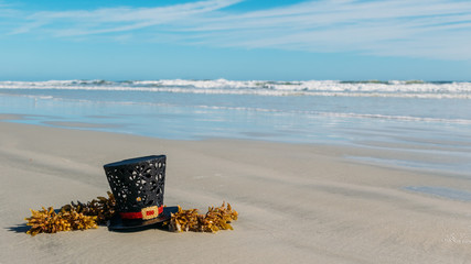 Christmas in Florida concept. Christmas snowman hat on the sandy shores of New Smynra Beach, Florida