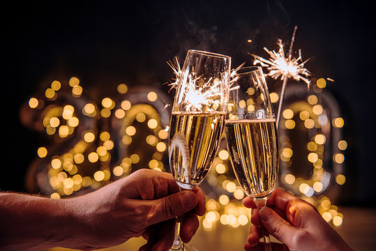 glasses with champagne, new year celebration concept