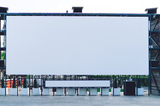 Large blank billboard installed on stage in park