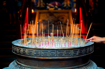 Censer with incense stick in the shrine