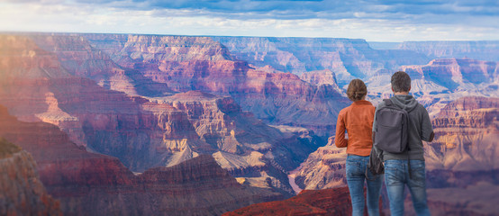 Young couple at the Grand Canyon. Wall mural