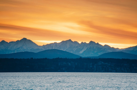 Snowy Olympic Mountains over Puget Sound near Seattle.