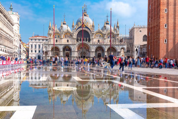 Garden Poster Venice Cathedral Basilica of Saint Mark and Piazza San Marco, St Mark Square, deluged by flood water during Acqua alta which means High water, Venice, Italy