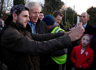 Britain's Prime Minister Boris Johnson poses for a photo during a general election campaign trail stop at Thornton-Cleveleys railway station in Manchester