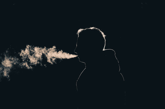 Sillouette of a smoking man in low key