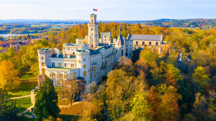 Hluboka Castle from 13th century. Amazing destination with historic château in South Bohemia, Czech Republic. Aerial view to famous European landmark.