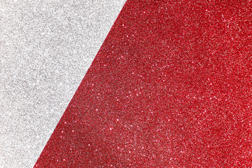 Silver and red defocused glitter backround with place for text.