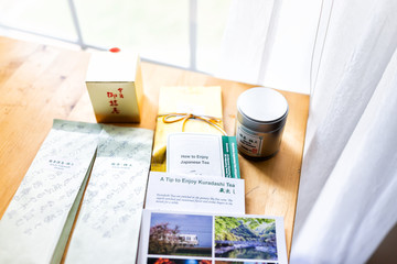 Herndon, USA - November 2, 2018: Many packages of Hibiki-an famous exporter of Japanese green tea, on wooden table in room by window, including instuctions, Kuradashi, matcha, sencha