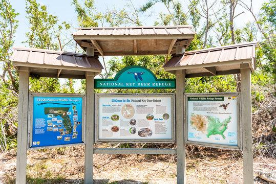 Big Pine Key, USA - May 1, 2018: Florida Keys, closeup of blue lake pond information sign for National Key Deer Refuge