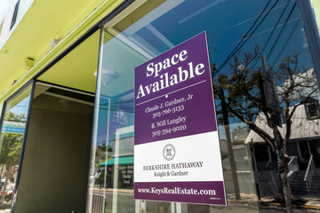 Key West, USA - May 1, 2018: Business space lease in Florida city island, sign for Berkshire Hathaway property real estate realtor, purple color on window