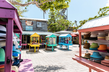 Key West, USA - May 1, 2018: Duval street Mallory Square shopping architecture with nobody in Florida city travel, sunny day, merchants vendors