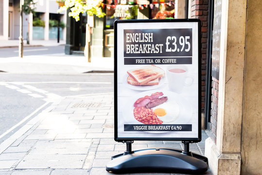 London, UK - June 22, 2018: Closeup of Placard sign for English Breakfast special cafe restaurant outside street sidewalk during sunny summer day morning in Pimlico Victoria