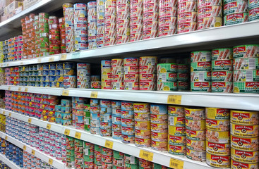 KUALA LUMPUR, MALAYSIA -MARCH 04, 2018: Processed can food are arranged on a supermarket shelf followed its types and brands.