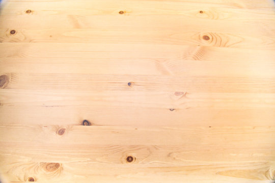 Background of brown pine Board with knots of bright wood structure. Backgrounds, structures, designs.