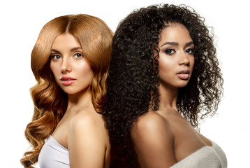 Multi-ethnic beauty. Caucasian and African. Different ethnicity women on white background. Beautiful vogue girls.
